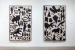 Two large embroidered hangings with black shapes and silhouettes of fantasy creatures on a tan ground colour.