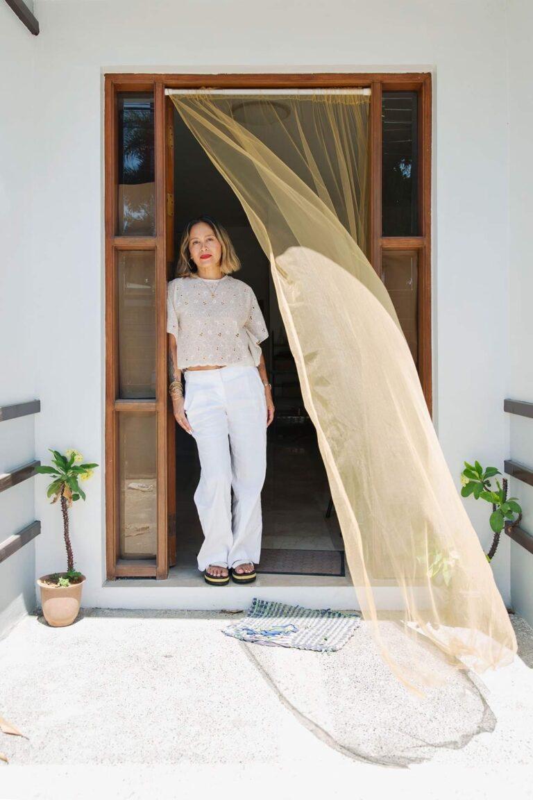 The image depicts fashion designer Caroline Mangosing