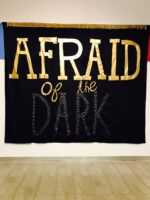 This image depicts a banner made by Syrus Marcus Ware