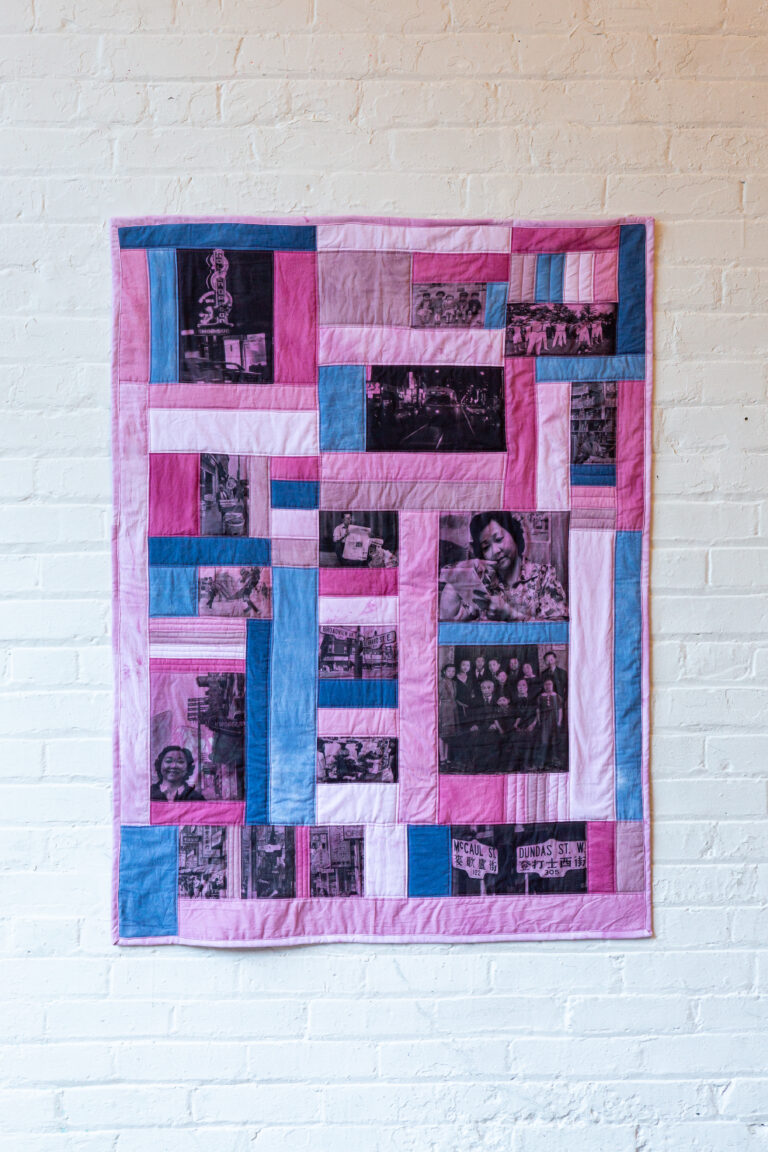 This image shows a textile quilt by artist Holly Chang
